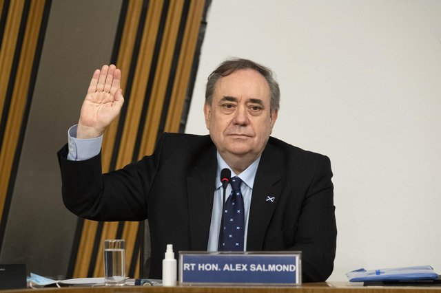 Former first minister Alex Salmond is sworn in before giving evidence to a Scottish Parliament Harassment committee