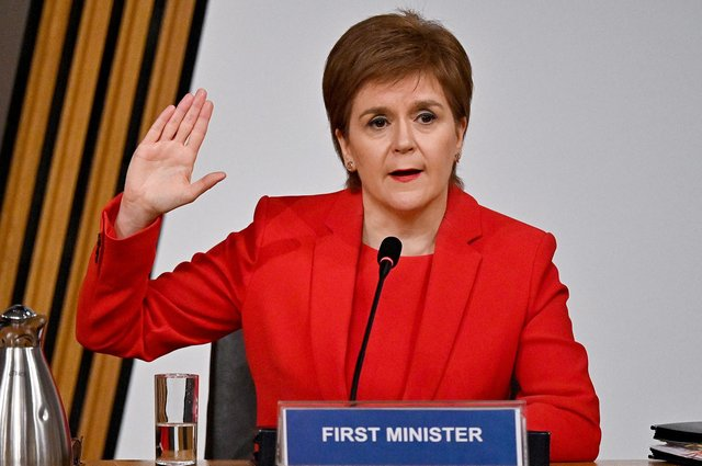 Nicola Sturgeon takes the oath before giving evidence to the Committee on the Scottish Government Handling of Harassment Complaints (Picture: Jeff J Mitchell/PA)