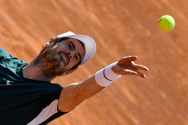 Andy Murray serves during his doubles match with Liam Broady against Germany's Kevin Krawitz and Romania's Horia Tecau in Rome. Picture: AFP via Getty Images