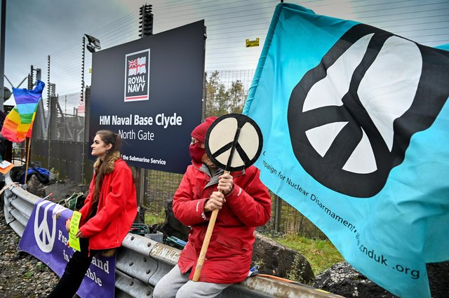 Anti-nuclear campaigners protest outside the Faslane nuclear submarine base (Picture: Jeff J Mitchell/Getty Images)