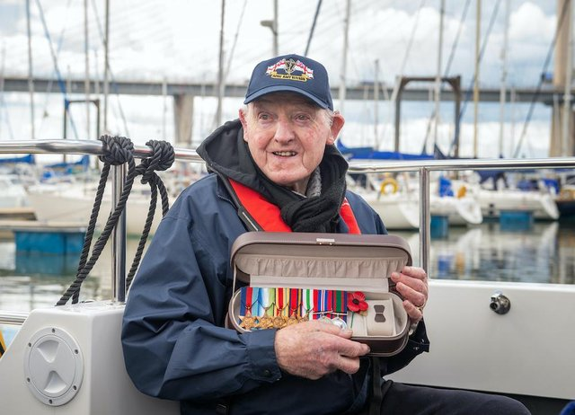 Royal Navy World War Two gunner Harry Hogg, 102, proudly wore his medals when he came aboard.
