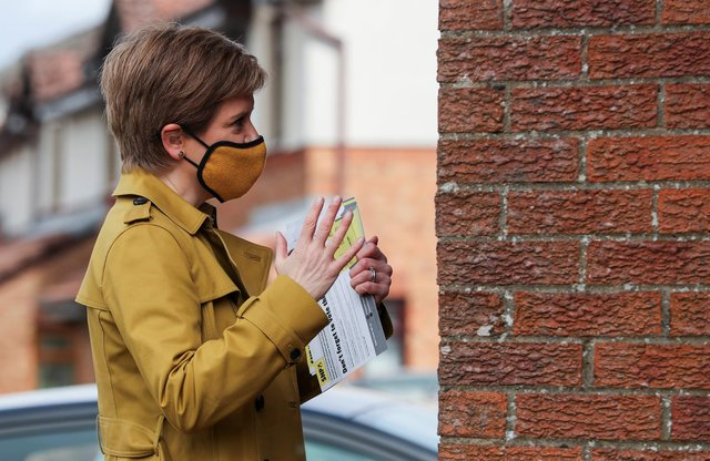 First Minister Nicola Sturgeon speaks to a member of the public. Picture: Russell Cheyne - Pool/Getty Images