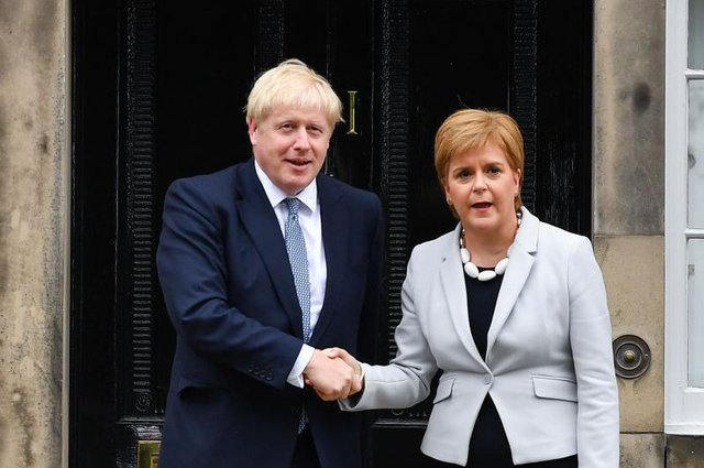 Nicola Sturgeon and Boris Johnson need to recognise the urgent need for a Covid inquiry (Picture: Jeff J Mitchell/Getty Images)