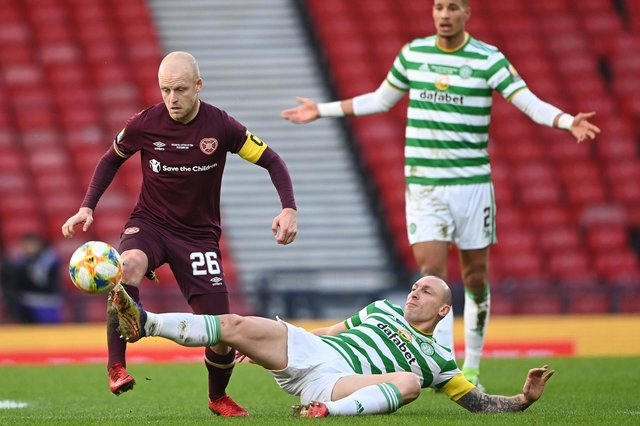 Hearts captain Steven Naismith with his Celtic counterpart Scott Brown.