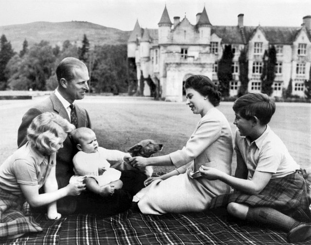 At home at Balmoral. The Duke of Edinburgh is pictured with The Queen and children in September 1960.