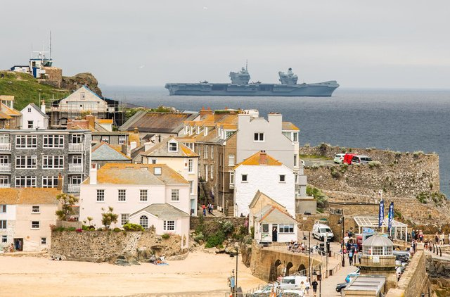 Joe Biden and Boris Johnson have already arrived  in Cornwall for a series of meetings ahead of the G7 summit, which officially starts today (Friday). HMS Prince of Wales patrols waters off St Ives as security remains at its highest level. PIC: SWNS.