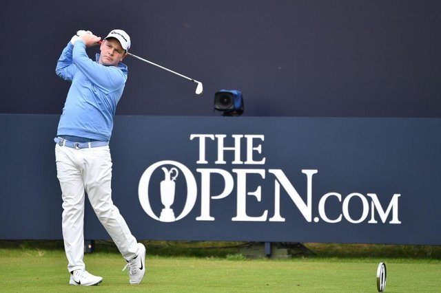 Bob MacIntyre tees off in the first round of the 148th Open at Royal Portrush, where he tied for sixth to secure an exemption for next week's delayed staging at Royal St George's. Picture: Paul Ellis/AFP via Getty Images.