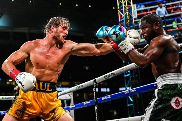 YouTube personality Logan Paul throws a left at former world welterweight king Floyd Mayweather in an eight-round exhibition bout at Hard Rock Stadium in Miami. Picture: CHANDAN KHANNA/AFP via Getty Images