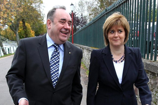 Alex Salmond and Nicola Sturgeon, pictured in 2011 on their way to the 77th Scottish National Party conference in Inverness (Picture: Andrew Milligan/PA Wire)