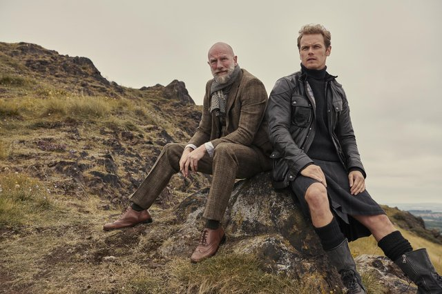 Sam Heughan and Graham McTavish take a breather on their tour of the Highlands.