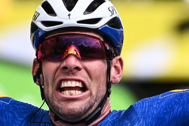 Stage winner Team Deceuninck Quickstep's Mark Cavendish of Great Britain celebrates as he crosses the finish line of the 4th stage of the 108th edition of the Tour de France cycling race, 150 km between Redon and Fougeres, on June 29, 2021.(Photo by ANNE-CHRISTINE POUJOULAT/AFP via Getty Images)