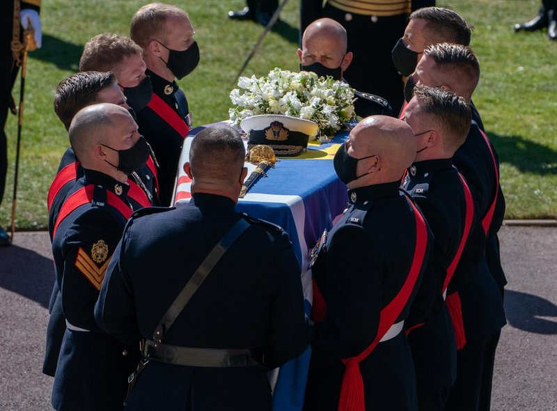 The Duke of Edinburgh's coffin, covered with his Personal Standard, is carried into St George's Chapel, Windsor Castle, Berkshire, ahead of the funeral of the Duke of Edinburgh.