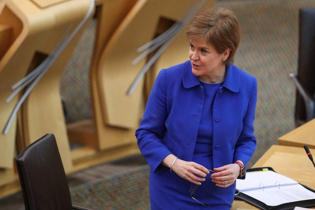 Nicola Sturgeon makes a statement in Holyrood about the plans to ease the Covid lockdown restrictions (Picture: Russell Cheyne/pool/AFP via Getty Images)