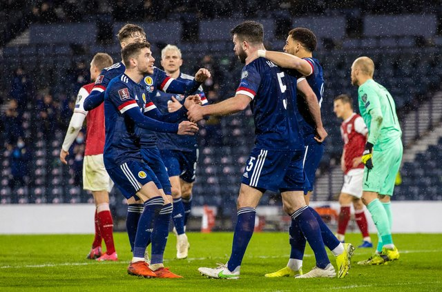 Scotland players celebrate after Grant Hanley makes it 1-1 against Austria. (Photo by Craig Williamson / SNS Group)