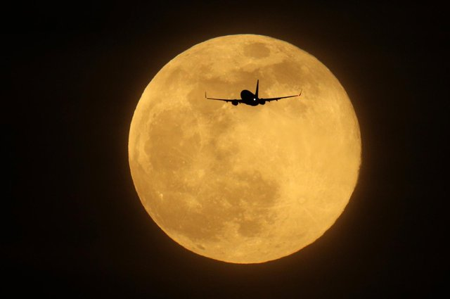 Supermoons appear bigger and brighter in the sky because they are slightly closer to the Earth (Getty Images)
