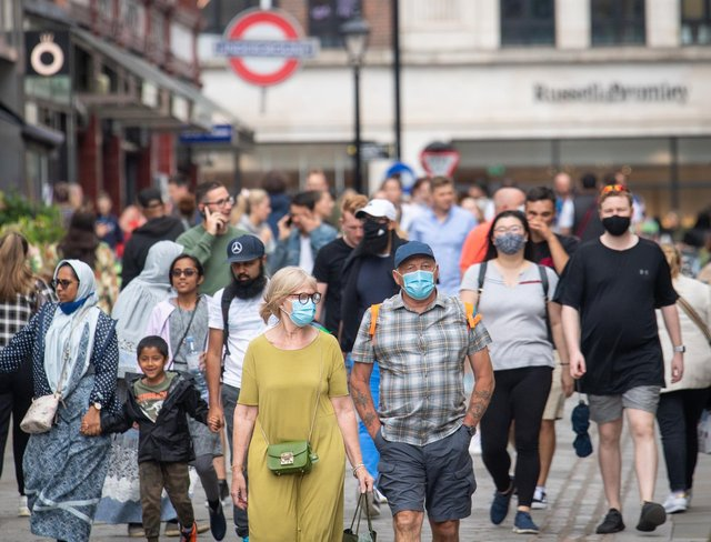 """People wearing face masks among crowds of pedestrians in Covent Garden, London. Prime Minister Boris Johnson is expected to scrap social distancing and mask-wearing requirements on England's so-called """"Freedom Day"""" of July 19. Photo: Dominic Lipinski/PA Wire"""