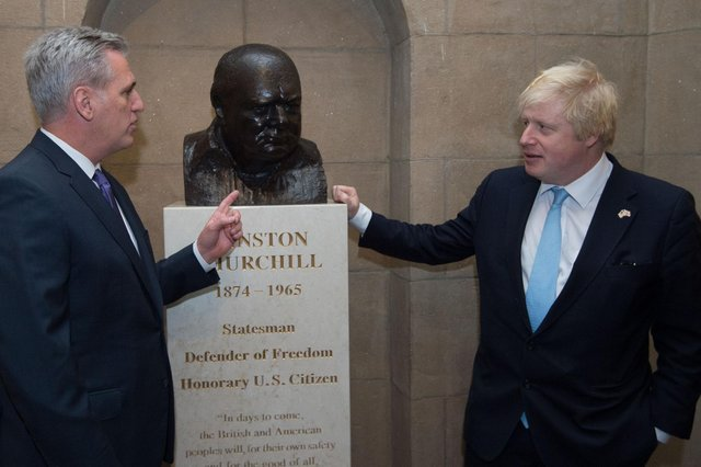 Boris Johnson gazes at a bust of Winston Churchill in the US House of Representatives in Washington DC in 2015 (Picture: Stefan Rousseau/PA)