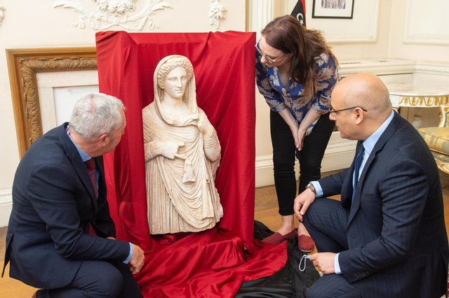 British Museum staff and Libyan Embassy charge d'affaires Mohamed Elkoni, right, view the second-century funerary statue depicting Demeter or Persephone at the Libyan Embassy in central London (Picture: Dominic Lipinski/PA)