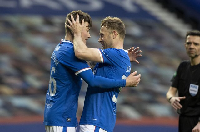 Rangers' Nathan Patterson (L) celebrates making it 4-0 with Scott Arfield during a Scottish Cup Third Round tie between Rangers and Cove Rangers at Ibrox Stadium, on April 04, 2021, in Glasgow, Scotland. (Photo by Alan Harvey / SNS Group)