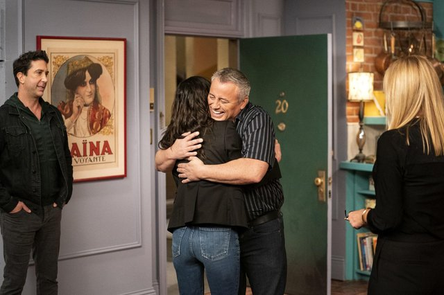 """David Schwimmer, from left, Courteney Cox, Matt LeBlanc and Jennifer Aniston in a scene from the """"Friends"""" reunion special (Terence Patrick/HBO Max via AP)."""
