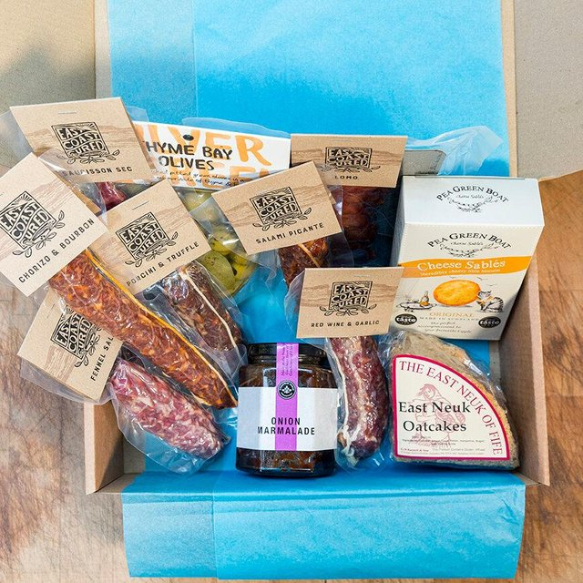 The Savoury Sharing Hamper from East Coast Cured includes a selection of the charcuterie's award-winning salamis alongside other savoury Scottish and English snacks.