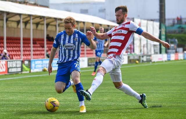 Kilmarnock's Rory McKenzie (left) is closed down by Hamilton's Scott McMann during the Rugby Park's last day victory - a result that could not spare them the play-offs but send them into the ties against Dundee in decent form. (Photo by Craig Foy / SNS Group)
