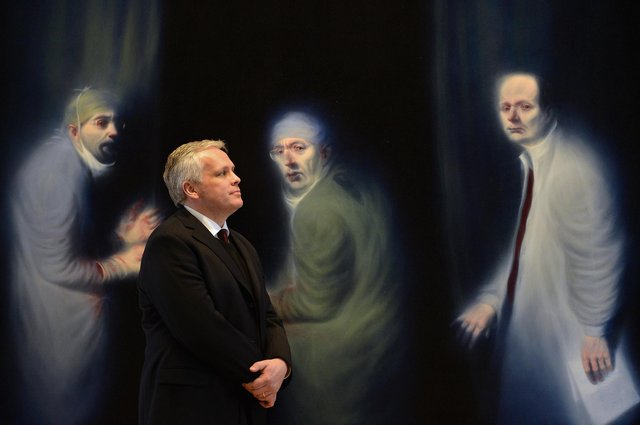 Christopher Baker, director of European and Scottish art and portraiture at the National Galleries of Scotland, poses in front of the Three Oncologists by Ken Currie (Picture: Jeff J Mitchell/Getty Images)