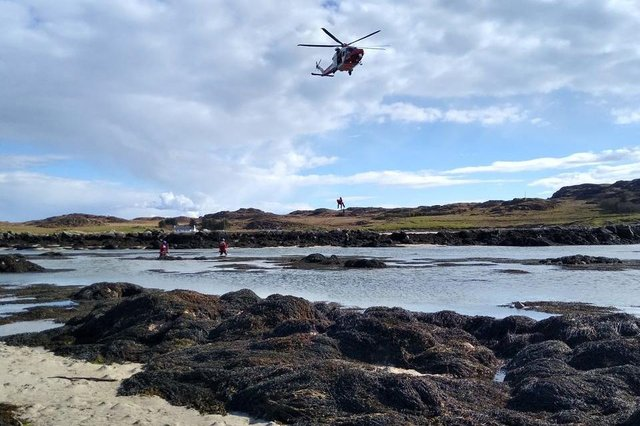 The Coast Guard helicopter winches the casualty from Mull to safety on the mainland (Photo: Craignure Coastguard Rescue Team).