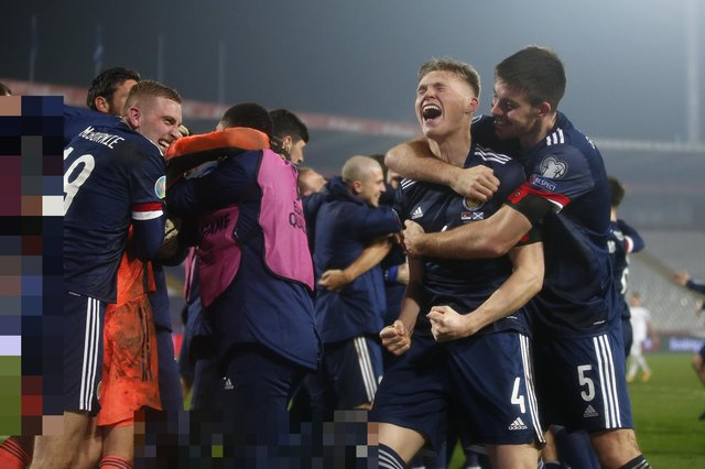 BELGRADE, SERBIA - NOVEMBER 12: Scott McTominay of Scotland and Declan Gallagher of Scotland celebrate after the UEFA EURO 2020 Play-Off Final between Serbia and Scotland at Rajko Mitic Stadium on November 12, 2020