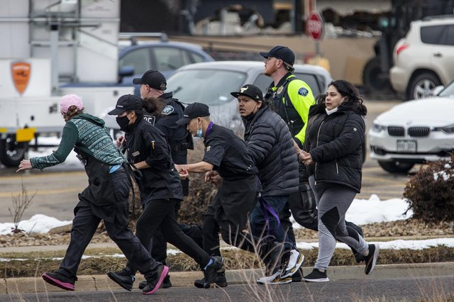 Shoppers are evacuated from a King Soopers grocery store after a gunman opened fire on March 22, 2021 in Boulder, Colorado (Photo by Chet Strange/Getty Images).