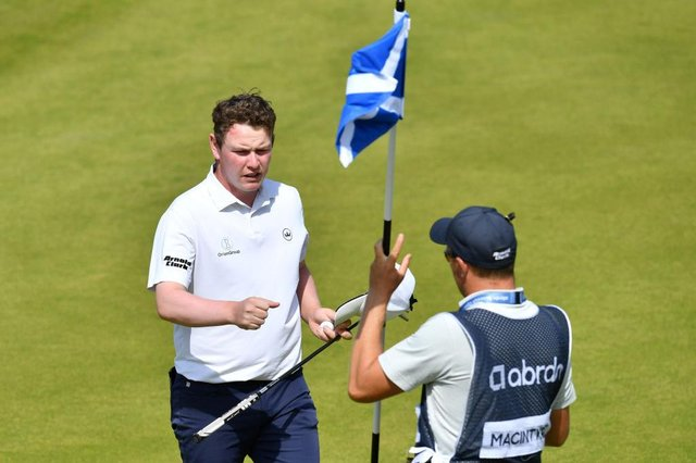 Bob MacIntyre fist bumps caddie Mike Thomson at the end of the third round in the abrdn Scottish Open at The Renaissance Club. Picture: Mark Runnacles/Getty Images.