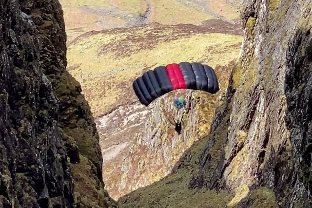 A base jumper is pictured from the ridge ofAonach Eagach,Glen Coe (Picture via SWNS)