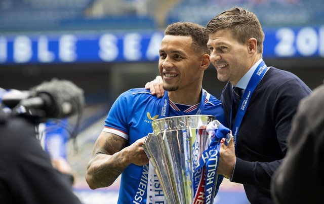 Rangers captain James Tavernier and manager Steven Gerrard with the Scottish Premiership Trophy at full time during the Scottish Premiership match  between Rangers and Aberdeen  at Ibrox Stadium, on May 15, 2021, in Glasgow, Scotland. (Photo by Craig Williamson / SNS Group)