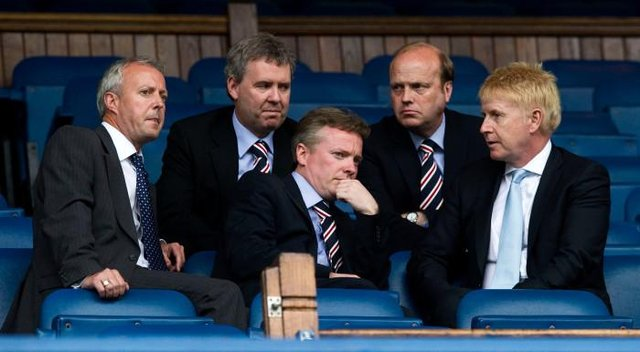 Four days after taking ownership of Rangers, Craig Whyte (centre) in discussion with (from left) David Grier, Gary Withey, Phil Betts and Donald Muir before a match against Dundee United at Ibrox. (Photo by Alan Harvey/SNS Group).