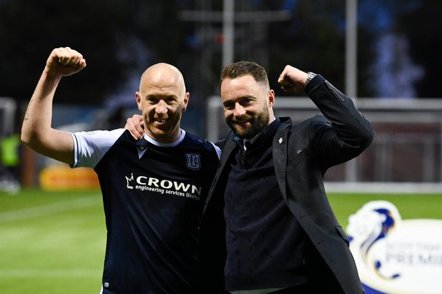 Dundee skipper Charlie Adam and manager James McPake embrace after the Premiership play-off win over Kilmarnock  (Photo by Rob Casey / SNS Group)