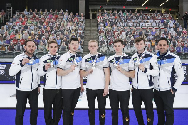 Scotland show off their silver medals after the final of the BKT Tires & OK Tire World Men's Curling Championship in Calgary. Picture: WCF/Jeffrey Au