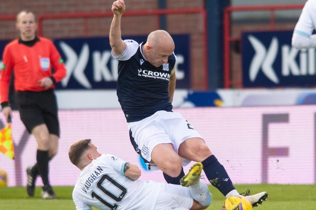 Dundee skipper Charlie Adam (right) battles for the ball with Raith Rovers goalscorer Lewis Vaughan  (Photo by Mark Scates / SNS Group)