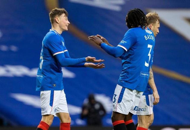 Rangers' Nathan Patterson (L) celebrates making it 4-0 with Calvin Bassey during a Scottish Cup Third Round tie between Rangers and Cove Rangers at Ibrox Stadium, on April 04, 2021, in Glasgow, Scotland. (Photo by Alan Harvey / SNS Group)