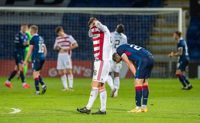 Jamie Hamilton buries his head in his shirt after the full-time whistle sounded in Dingwall. Picture: SNS