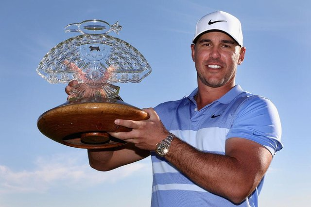 Brooks Koepka poses with the trophy after winning the the Waste Management Phoenix Open at TPC Scottsdale. Picture: Christian Petersen/Getty Images.