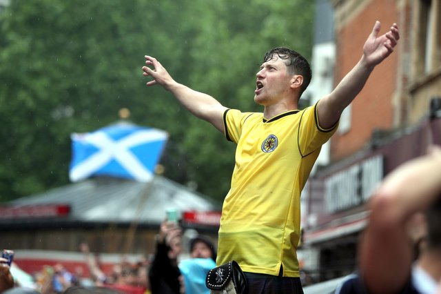Scotland fans gather in Leicester Square before the UEFA Euro 2020 match between England and Scotland later tonight.