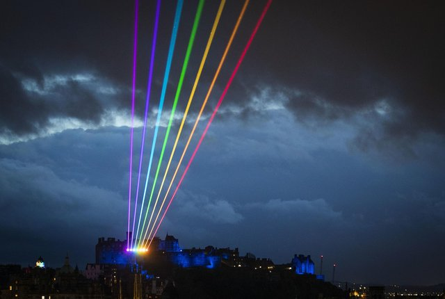 The night sky in Edinburgh was lit up by a 'Global Rainbow' laser art installation as a message of 'love, hope and optimism' from the city to the rest of the world. Picture: Jane Barlow/PA Wire