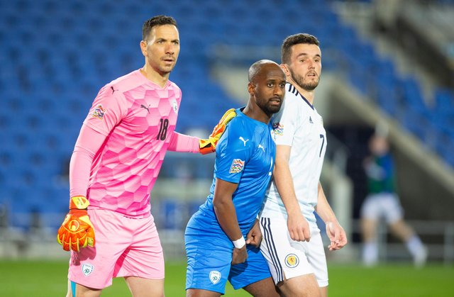 Ofir Marciano and Eli Dasa of Israel challenge John McGinn of Scotland during the UEFA Nations League group stage match between Israel and Scotland at Netanya Stadium on November 18, 2020 in Netanya, Israel. (Photo by Lior Mizrahi/Getty Images)