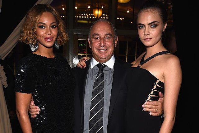 Beyonce Knowles, Sir Philip Green and Cara Delevingne at the Topshop Topman New York City flagship opening dinner in 2014 (Photo: Dimitrios Kambouris/Getty Images)