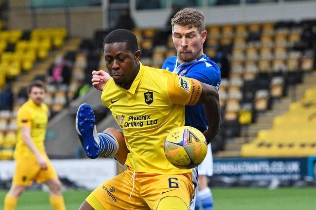 Marvin Bartley holds off St Johnstone's David Wotherspoon as Livingston succumbed to their first defeat under manager David Martindale  (Photo by Sammy Turner / SNS Group)