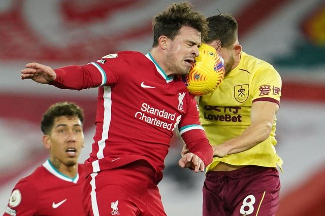 Liverpool's Swiss midfielder Xherdan Shaqiri (L) heads the ball against Burnley's English midfielder Josh Brownhill (R) during the English Premier League football match between Liverpool and Burnley at Anfield in Liverpool, north west England on January 21, 2021. (Photo by Jon Super / POOL / AFP)