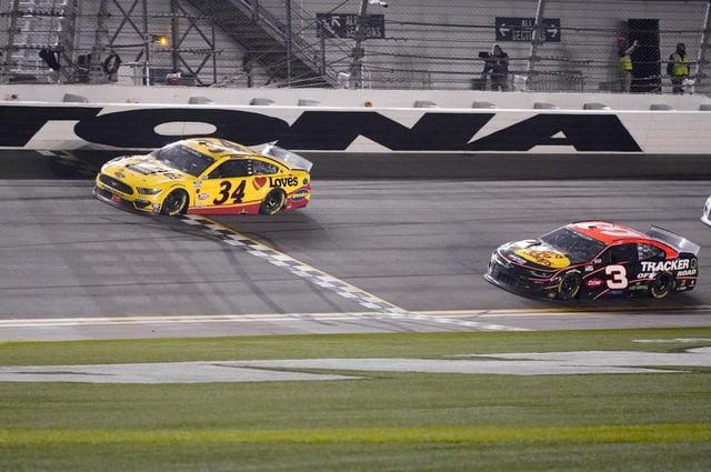 Michael McDowell crosses the finish line ahead of Austin Dillon to win the NASCAR Daytona 500. Picture: John Raoux/AP
