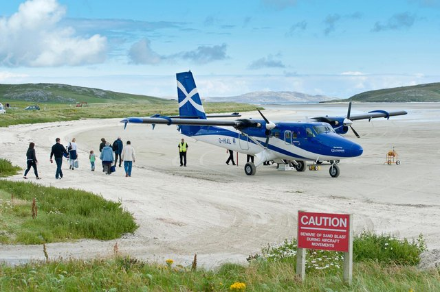 Planes flying into the island of Barra famously land on the beach (Picture: Stefan Auth/imageBROKER/Shutterstock)