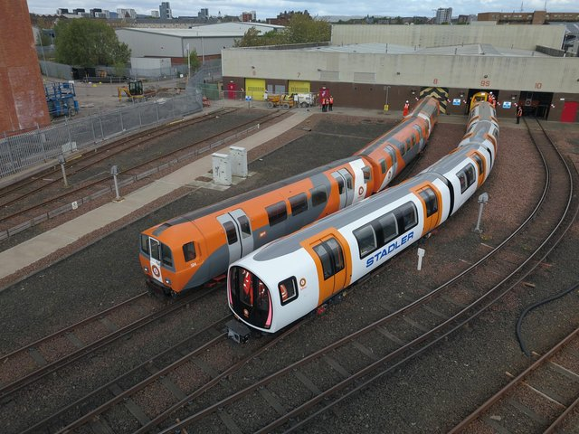 One of the new driverless trains, right, beside a current train. Picture: SPT