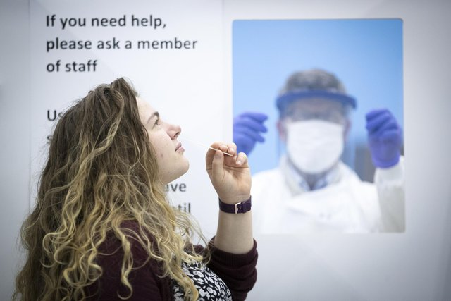 A woman takes a lateral flow Covid-19 test. Picture: PA Media